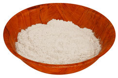 Flour in wooden bowl. Stock Photos
