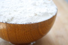 Flour in wooden bowl. All purpose flour in a wooden bowl Royalty Free Stock Photos