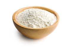 Flour in wooden bowl Stock Images