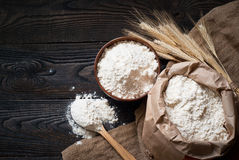 Flour in a wooden bowl Stock Photo