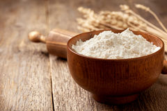 Flour in a wooden bowl Royalty Free Stock Images