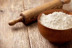 Flour in a wooden bowl Royalty Free Stock Image