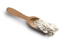 Flour in wooden scoop Royalty Free Stock Image