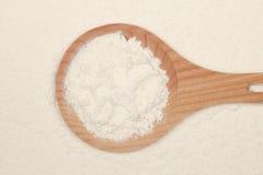 Flour on a wooden spoon Stock Photo
