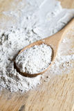 Flour in a wooden spoon Stock Images
