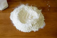 Flour on a wooden table stock images
