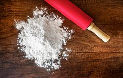 Flour on a wooden table royalty free stock photography