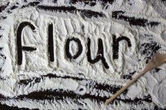 Flour word written on the flour royalty free stock image