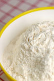 Flour in yellow bowl. Flour in white-yellow bowl - main ingredient for bakery Royalty Free Stock Image