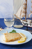 Floured cod cooked in a pan Stock Image