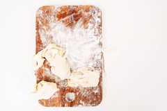 Floured cutting board with raw dough top view Stock Photos