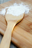 Floured Spoon. Spoon on a cutting board, covered in flour Royalty Free Stock Images