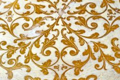 Gold flourish design ornament. Decorative white background. royalty free stock image