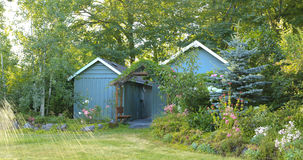 Flourishing farm backyard with sheds and garden house Royalty Free Stock Photography