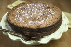 Flourless Chocolate Cakes on a Yellow Pedestal Plate royalty free stock images