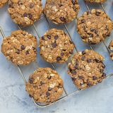 Flourless gluten free peanut butter, oatmeal and chocolate chips cookies on cooling rack, top view, square. Format Stock Photos