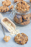 Flourless gluten free peanut butter, oatmeal and chocolate chips cookies in glass jar and on the table, vertical. Flourless gluten free peanut butter, oatmeal Stock Images