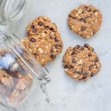 Flourless gluten free peanut butter, oatmeal and chocolate chips cookies in glass jar, top view, square. Format Royalty Free Stock Image