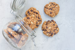 Flourless gluten free peanut butter, oatmeal and chocolate chips cookies in jar, top view, horizontal Royalty Free Stock Photography