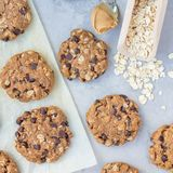 Flourless gluten free peanut butter, oatmeal and chocolate chips cookies on parchment, top view, square. Format Stock Photography