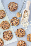 Flourless gluten free peanut butter, oatmeal and chocolate chips cookies on a parchment, top view, vertical Royalty Free Stock Photography