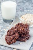 Flourless no bake peanut butter and oatmeal chocolate cookies, with glass of milk, vertical. Flourless no bake peanut butter and oatmeal chocolate cookies with stock image