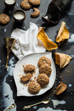 Flourless Walnut Cookies, Milk and Cherry Leaves Messy Still Life Stock Photos