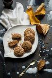 Flourless Walnut Cookies, Milk and Cherry Leaves Messy Still Life Royalty Free Stock Images