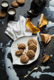 Flourless Walnut Cookies, Milk and Cherry Leaves Messy Still Life Royalty Free Stock Photo