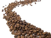 Flow of coffee beans. Royalty Free Stock Photo