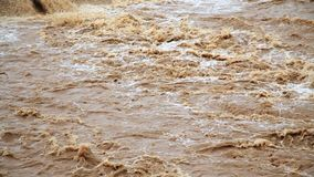 The flow of dirty water after the flood. Increased water level due to heavy rains stock footage