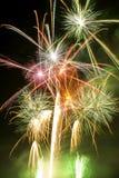 Flow of fireworks bursting Royalty Free Stock Image