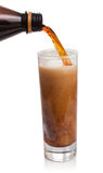 Flow of kvass in glass with froth Royalty Free Stock Image