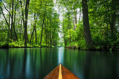 Flow line Spree Forest near Berlin traveled on a wooden paddle boat. A beautiful flow line through the recreation area Spree Forest near Berlin. Boat and Royalty Free Stock Photo