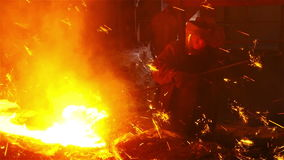 The flow of molten iron stock video footage