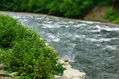 Flow Mountain River In Rocky Shores Landscape Stock Photo