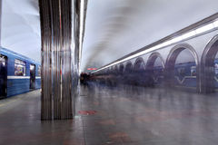 Flow of passengers on platform metro station at rush hour. Royalty Free Stock Images