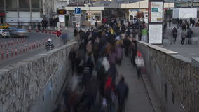 The flow of people coming to the train station after work, time lapse stock footage
