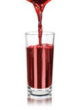 The flow of pomegranate juice being poured into glass Royalty Free Stock Photography