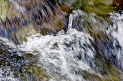 Flow of the raging waterfall Royalty Free Stock Photo