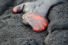 Flow of red hot lava. Closeup Royalty Free Stock Images