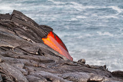 Flow of red hot lava into Pacific Ocean Stock Images