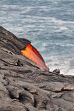 Flow of red hot lava into Pacific Ocean Stock Image