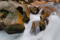 Flow though rock. Water flow through strange rocks Royalty Free Stock Photography