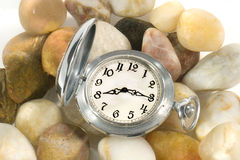 Flow of Time. Ancient pocket watch under water (on pebbles) symbolizing the flow of time Royalty Free Stock Image