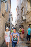 The flow of tourists on the narrow street of old Budva in Montenegro Stock Photography