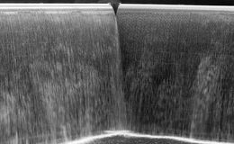Flow of water in a big  fountain, black and white Royalty Free Stock Image