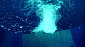 Flow water in a blue slide in aqua park. Water slides in summer aqua park. Flow water in a blue slide in water park. Water slides in summer aqua park. Water stock video footage