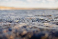 Flow of water close up. Quiet river water in the evening light background,flow of water close up stock photography