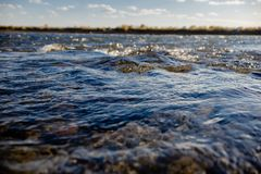 Flow of water close up. Quiet river water in the evening light background,flow of water close up royalty free stock image